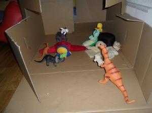 Dinosar leker dockteater.